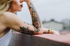 Tattooed girl enjoying on balcony