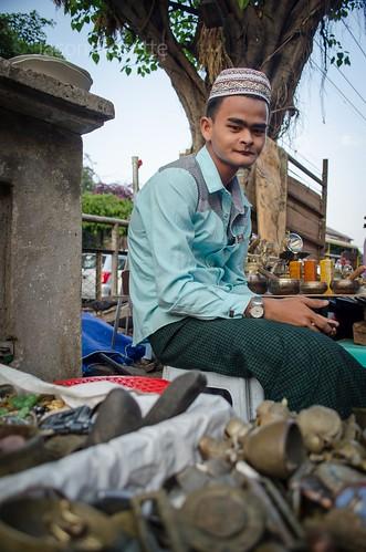 Vintage Junk Seller, Seated on a Wall in Rangoon, Burma (#1)