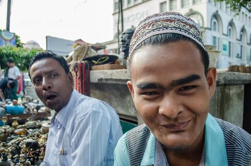 Close up of vintage junk seller and colleague, Rangoon Burma (#1)