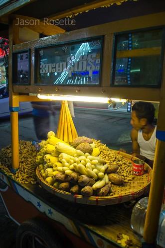 Corn and Yam Seller Outside the Movie House, Rangoon, Burma