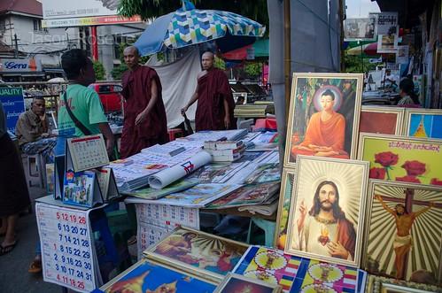 Buddha and Jesus Together on Seller's Table, Rangoon Burma