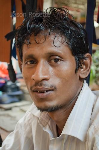 Close Up: Belt Seller, Downtown Rangoon, Burma