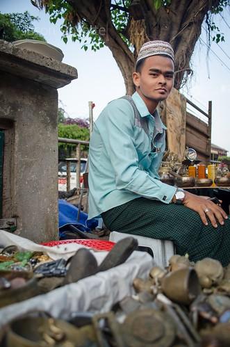 Vintage Junk Seller, Seated on a Wall in Rangoon, Burma (#2)