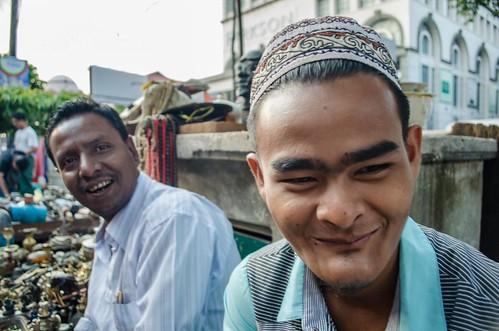 Close up of vintage junk seller and colleague, Rangoon Burma (#2)