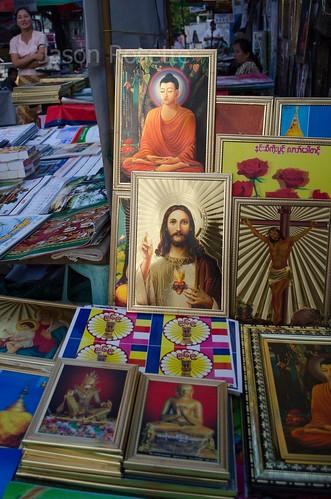 Buddha and Jesus Together on Seller's Table, Rangoon Burma (vertical)