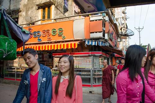 Street Corner in  Rangoon, Burma: Young Couple Passing