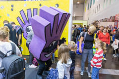 Children meet the purple mascot of card game Dobble at the SPIEL 19 gaming fair in Essen