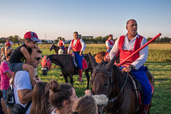 Garbed horse riders awaiting the start of a spear throwing competition