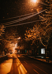 Empty road in winter night