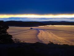 Sunrise. The Coastguard at full speed. Hvaler, Norway