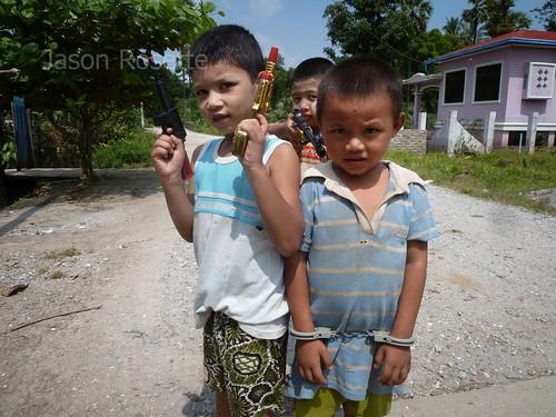 Three Boys Playing 'Criminal' Pose for the Camera, Burma