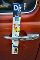 Ad booklet in a car door handle. Excessive advertising