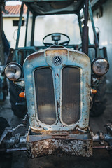 The front of an old and rusty Rakovica tractor