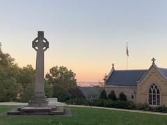 Celtic cross, St. Albans School, distant evening view to U.S. Capitol, Washington, D.C.