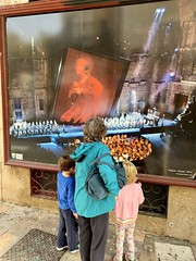 The twins and Ruth admire a poster of a staging of Tosca recently in the Roman amphitheater in Orange