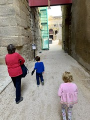 Ruth and the twins walk into the ancient Roman amphitheater in Orange
