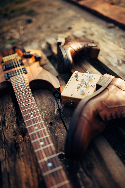 Photo:Music instruments with rock shoes, on a wooden table By shixart1985