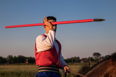 Horse rider holding a javelin in hand