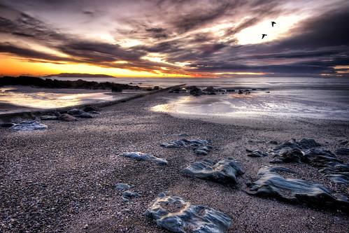 rocks sand and sky