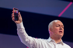 Oliver Ratzesberger, CEO and President of leading data analytics corporation Teradata, holds an iPhone in the hand and shows transactions made with the Apple Card