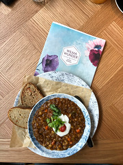 Vegan Lentil Stew with fresh bread and almond yoghurt in Cologne