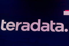 The logo of Teradata, the cloud analytics company delivering Pervasive Data Intelligence, on the large screen on the Digital X stage in Cologne