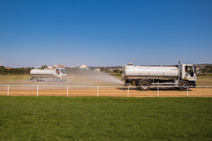 Water truck spraying horse racing track