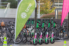 Lime Scooters parked with Telekom branding at Digital X in Cologne