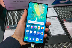 Huawei Mate 20X 5G co-engineered with Leica in the hand of a man displayed at Digital X in Cologne