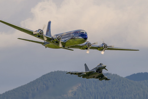 Douglas DC-6B (Flying Bulls) escorted by a Eurofighter Typhoon (Austrian Air Force)