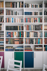 Image of colorful books in shelves