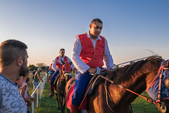Horse riders at knight competition with sabers in hands