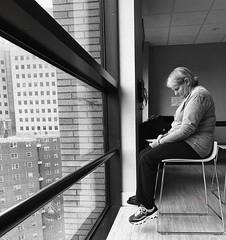 Older Woman Ponders Her Phone