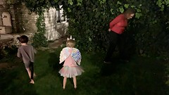 The twins look for Halloween candy in our backyard in France as Kate helps - Photo of Morières-lès-Avignon
