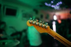 Back side of Fender stratocaster guitar neck on stage.