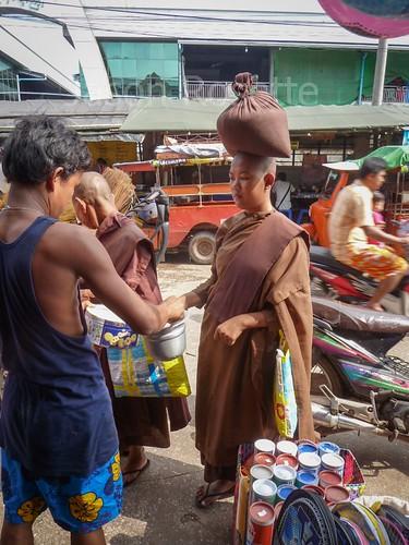Buddhist Nun with Sack of Rice Balanced on her Head, Mawlyamine, Burma