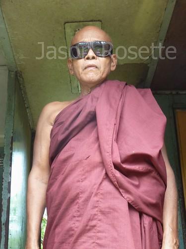 Medium view, monk with sun glasses in Train Doorway
