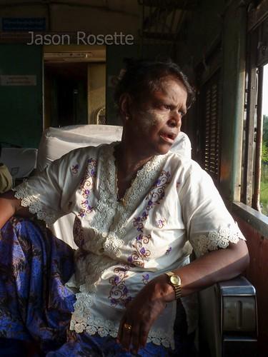 Woman Looking out Train Window in Burma