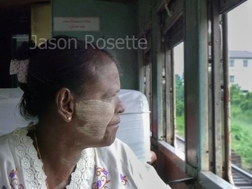 Medium Profile of Woman Looking out Window of Train in Burma