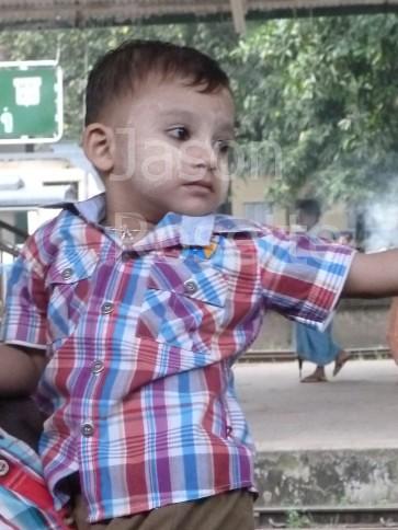Happy Boy Being Held at Train Platform in Burma