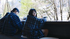 SAKURAKO sits in a hot foot spa.