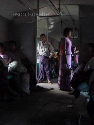 Wide View Woman in Purple Dress on Train in Burma