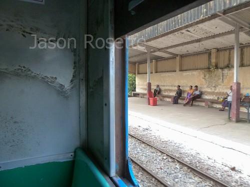 Passengers Wait on Train Platform in Burma, Southeast Asia