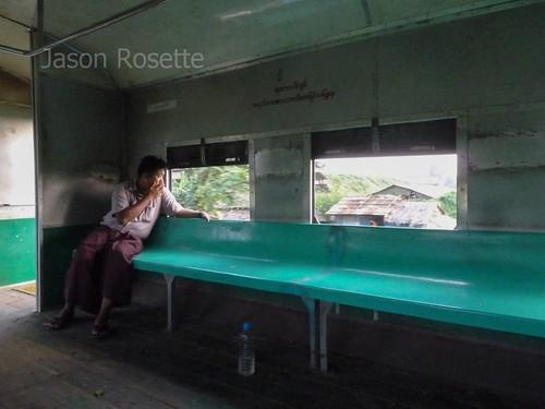 Man Sits Alone on Train in Burma