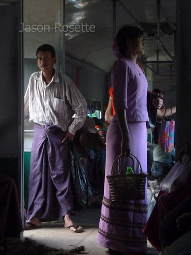 Medium View Woman in Purple Dress on Train in Burma