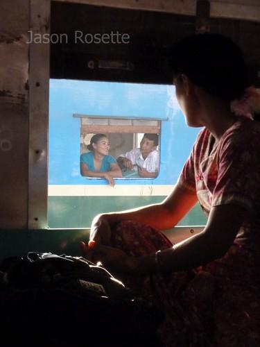 Silhouette of Woman at Train Window in Burma (closer)