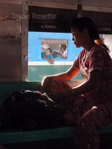 Silhouette of Woman at Train Window in Burma