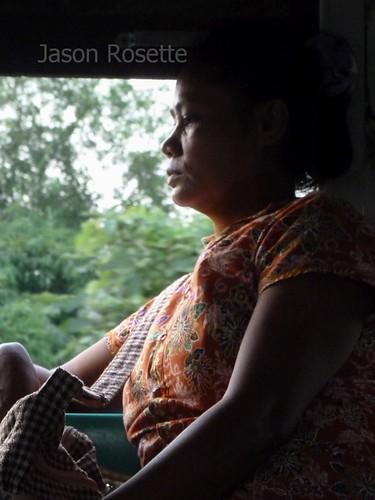 Profile of Thoughtful Woman on a Train in Burma