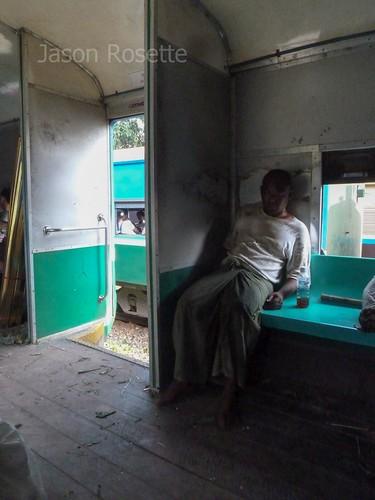 Man Sleeping on a Train in Burma