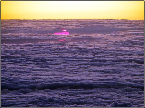Sunset under a sea of clouds